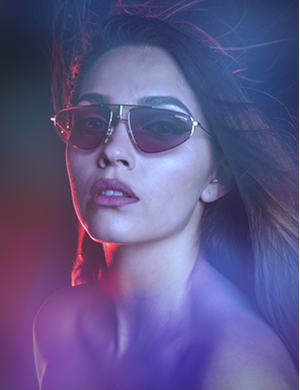 A beautiful brunette woman wearing sunglasses